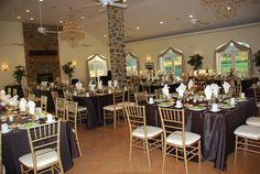Square tables instead of round tables added a cool element to this upscale classy reception at the Briar Patch Bed and Breakfast Inn