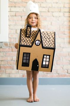 host House Themed birthday party complete with a paper house crown and cardbaord house as a gift! | mer mag