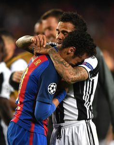Neymar of Barcelona is embraced by Dani Alves of Juventus after the UEFA Champions League Quarter Final second leg match between FC Barcelona and Juventus at Camp Nou on April 19, 2017 in Barcelona, Spain.