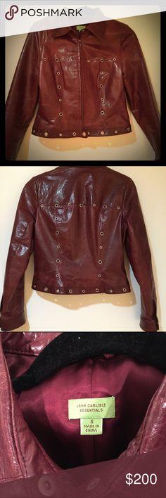 John Carlisle leather burgundy cropped jacket John Carlisle treated leather burgundy cropped Moto jacket with grommets on front and back. Waist length. Size small. John Carlisle Jackets & Coats