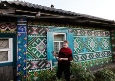 Olga Kostina - Siberia, Russia - Decorated her wooden house with plastic bottle caps she collected for years with a hammer and nails by hand.