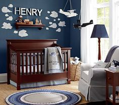 Image from http://www.glenrockdigitalphoto.com/wp-content/uploads/2014/08/blue-painting-a-baby-boys-room-ideas-2014-with-laminating-wooden-floor-and-lamps-also-dark-wooden-furniture-with-airplanes.jpg.