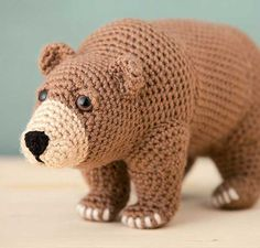 Bear is a loveable, brutish animal crocheted to depict its strength and character. Realistic features make you want to give him a bear hug! Bear connects with your inner self; it is a project that highlights a popular spirit guide, totem or mascot. Bear w Crochet Amigurumi, Crochet Bear, Cute Crochet, Amigurumi Patterns, Amigurumi Doll, Crochet Crafts, Crochet Dolls, Crochet Projects, Easy Crochet