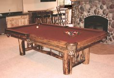 """Wilderness Madison billiard table built from naturally distressed Lodgepole pine, with hand-coped spruce """"Y""""s in the lower trestle."""