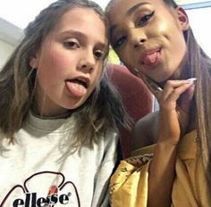 Ariana Grande with one of the injured girls at her concert, Evie Mills.