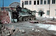 """A rare color photo, taken in March-April 1944, showing a Panzerkampfwagen VI Tiger from schwere Panzer-Abteilung 508 undergoing repairs in the Workshop Company's (Werkstattkompanie) position in front of the buildings of the former """"Arco"""" bomb factory near the Forte Tiburtino, Rome (Italy)."""