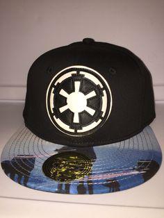 Big empire symbol with AT-ATs on brim
