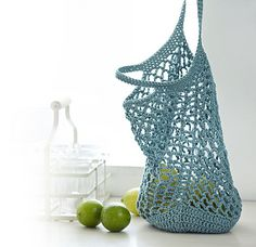 Do your part for the environment by making up this surprisingly roomy string bag. It holds more than a typical plastic bag and can be used again and again. The bag is made in the round and has a solid bottom to prevent smaller objects from falling out.