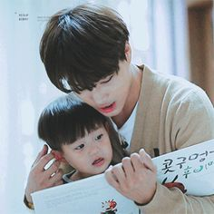Kai and Taeoh. This is so cute! My husband is reading to our baby while playing with his ear. :D