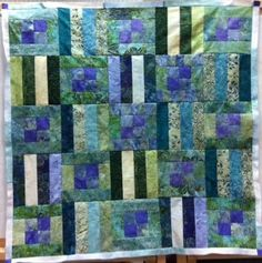 Batik Squares and Stripes is pieced from pre-cut strips and is a perfect quilt for beginners! www.hughsbooks.ca