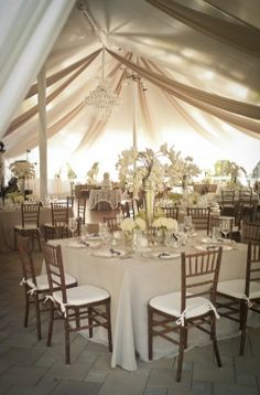 pole tent with draping and chandelier
