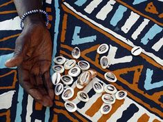 Fortune telling with cowrie shells, Saly, Thies, Senegal