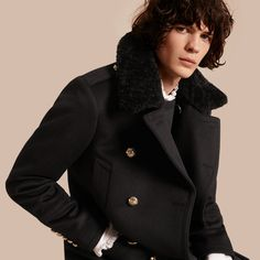 A Burberry pea coat redesigned with military trims and domed polished metal buttons, made from an insulating wool and cashmere blend for a noticeable soft hand feel.