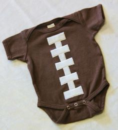 Dye a white onsie brown. Sew up or glue some white felt onto a brown onesie to make a football costume. --add a football crochet hat
