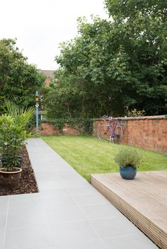 This fun garden has used our Light Grey Porcelain tiles as a great path and patio area. We love the Mediterranean feel of the space.
