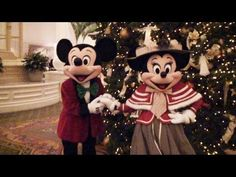 Mickey and Minnie Mouse in their Victorian outfits during Christmas week at Disney's Grand Floridian Resort, Walt Disney World