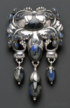 Georg Jensen, Important Silver and Labradorite Master Brooch,  designed as elaborate foliate and bud motifs set with and suspending labradorite cabochons and drops, no. 96, 3 3/4 x 2 1/4 in., signed GI 830S Denmark.