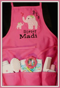 Big sister/new sibling apron. Makes a perfect gift the new big sister to wear when visiting her new sibling at the hospital. Would also make a great shower gift! This apron comes in bright pink with your choice of embroidery at the top. The size of this apron is most appropriate for 4 years old and younger. The pockets will be filled with a newborn diaper, a rattle, baby powder, baby lotion, and a hair/comb set (items in pocket may not be exactly as pictured). I am totally custom, so if…