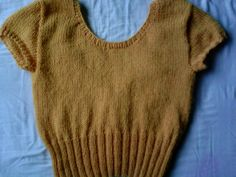 suéter a la cintura cuello circular,ptos usados:  jersey y elástico