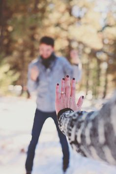 This is the cutest winter engagement ring picture ever! She just said yes, and he couldn't be happier. <3