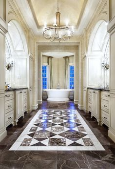Gorgeous!  Floors, tub, chandelier, love it all!