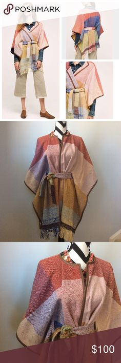 """{Anthropologie} Colorpane Poncho {Anthropologie} Colorpane Poncho by Nomad by Morgan Carper. Such a gorgeous piece😜 Can be worn with so many things. Color block. Fringe detail at the bottom. Faux leather trim detail. Detachable tie belt. Laying flat approx 30.5"""" long excluding the fringe. 45 wool 25 acrylic 25 polyester 5 other fibers. Size XS/S. NWT. Anthropologie Jackets & Coats"""