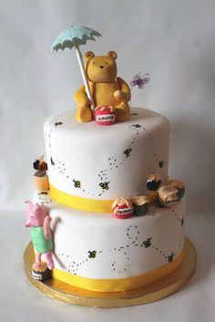 Classic Winnie the Pooh baby shower cake by Whisk Me Away