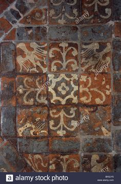 Winchester Cathedral, Hampshire. Medieval 13th century clay and glazed floor tiles in the retroquire Stock Photo