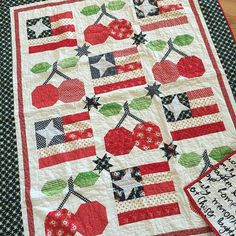 "beelori1Here's another version of my ""Old Glory"" block but with my ""Pie Cherries"" block added! It was made by @ericaarndt and she used the 12"" block sizes both from my book Farm Girl Vintage:) I love this!!! It's very George Washington-ish:) 🇺🇸❤️🍒"