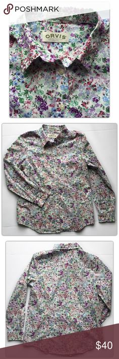 Women's Orvis Floral Button Down Shirt Size 12 Women's Orvis  Floral Button Down Shirt  Wrinkle Resistant Size 12  A burst of berry and tiger-lily blossoms flourish against the denim-blue background of our crisp wrinkle-resistant floral cotton blouse. Traditional button-front design with point collar and single-button cuffs. Shirttail hem. Washable.  Excellent pre-owned condition. Orvis Tops Button Down Shirts