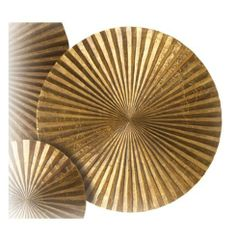 Apollo Medium Metal Wood Crimped Gold Wall Plaque Disc by Kathy Kuo Designs. $240.00. Weight: 11 lbs.. Use alone or clustered with several other size and depth Apollo plaques for a unique wall statement. Constructed out of solid wood interior. Hand finished carefully using brass foil. 18 inches diameter x 3 inches deep. Looking for a wow inducing piece? This small metal and wood plaque certainly creates a lot stir. Evoking mid century op art and Asian metal gong without effort, t...