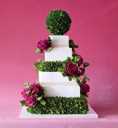 Enchanted by formal English gardens, Weinstock mixed the lush look of sugar-dough peonies and boxwood leaves with square tiers slathered in buttercream and topped with a topiary. http://sylviaweinstockcakes.com