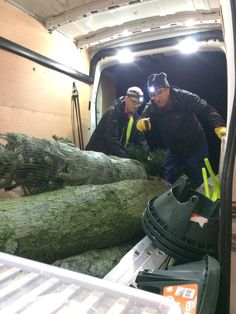 David and John loading the van with real, locally grown christmas trees for our customers.