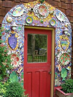 Mosaic artwork around door   It is very imaginative and creative, utilitarian etc.