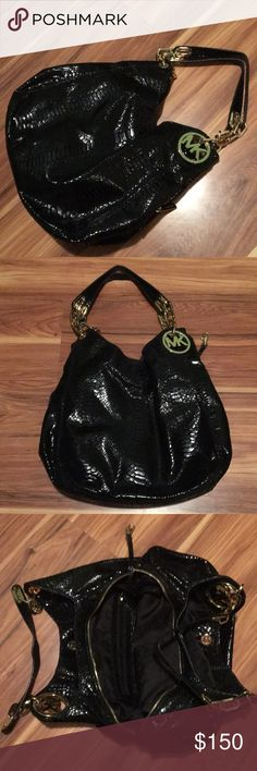XXL Michael Kors rare htf python leather purse Stunning python leather with heavy gold mk  on both sides ! 4 compartments . Zippered middle 2 button closure on sides . Gold chain and detail on the handles as well Michael Kors Bags