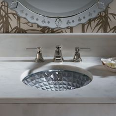 With reflective facets of cut glass, Kallos shines like a jewel in the bath or powder room.