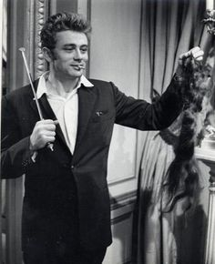 with wand and cigarette and... hairpiece??!!