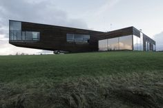 Outstanding Modern Architecture  Architectural bureau Natkevicius & Partners designed the Utriai Residence for a young family of three. This modern designed house is located in Vežaiciai of western Lithuania. The special feature of this open spacious architecture is a 15 m long part slightly rising up into the air, sheltering two cars beneath it.  Utriai Residence