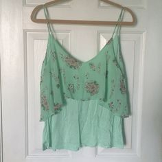 Double Layer Tank Cute real double layer tank. The top piece is floral. This is really cute and flowy and looks very flattering. Worn twice. Entro Tops Tank Tops