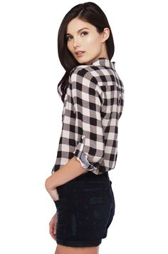 The  Plaid Button Up in White features a button down front, single chest pocket, long sleeves with buttoned strap detail, and a flowy body. Free standard U.S. shipping $75+.