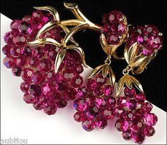 "Description: Vintage signed Trifari floral motif demi parure (brooch and clip on earrings), ""Briolette"" Collection, gold tone metal, fuchsia faceted glass rhinestones. Designer/Makers Marks, Hallmarks"