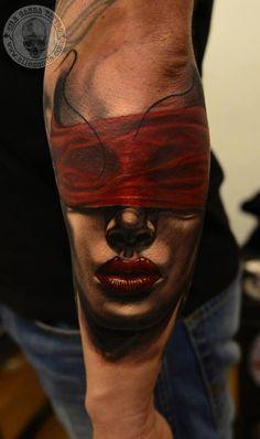 blind folded women tattoo