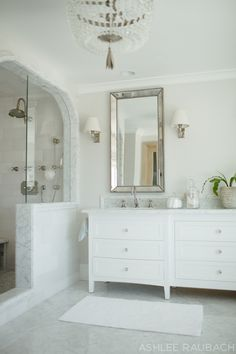 We feel this bathroom is fresh and timeless, with a white neutral palette. The counter, floors...