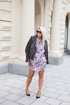 Love that combination with flower dress and leather jacket!