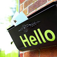 """Cheerful Mailbox A coat of metallic spray paint and a stenciled """"Hello"""" give the mailbox new life and make guests feel welcome."""