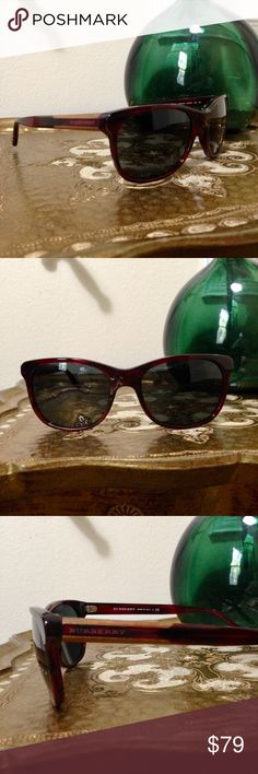 BURBERRY Red w/ Wood Side Detail Sunglasses Deep red frames w/ wood framed logo on side. The arms don't close perfectly flat, but other than that, great condition. Burberry Accessories Glasses