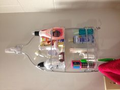 Get a shower caddy and hang it on command hooks for organization off the counter! Great for dorm rooms!