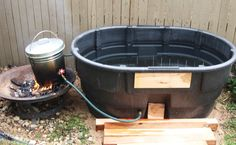 """One Pinner said, """"There was a great big smile on mommy's face when our and I unveiled the new off-grid fire heated hot tub we built her for Mother's Day"""". To make it, they recycled a 110 gallon water tank. Outdoor Tub, Outdoor Baths, Outdoor Bathrooms, Outdoor Life, Outdoor Showers, White Bathrooms, Luxury Bathrooms, Master Bathrooms, Dream Bathrooms"""