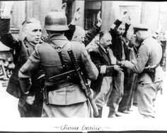 Warsaw, Poland, Jews who were removed from the bunkers having their papers checked and being searched for weapons.