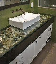 How gorgeous is this? I can imagine the whole bathroom now...relaxing forest green paint, river rock bed sink and mats, an old fashioned stand-alone white tub to match the sink...absolutely gorgeous!